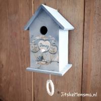 Muziekdoosje in vogelhuisje